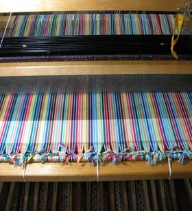 Upholstery fabric on the loom